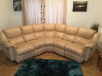 Top quality leather corner shaped sofa. Two end recliners, one electric. All pieces inter-changeable