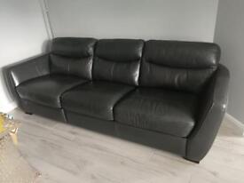 Leather corner sofa with footstool
