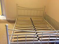 Kingsize cream metal bed frame