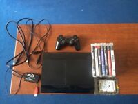 Sony PlayStation 3 Slim 12 GB Charcoal Black Console + 750GB hard drive + 7games