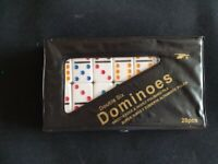 Double Six plastic dominoes with coloured spots.
