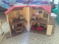 Sylvanian families bundle of houses, furniture and figures