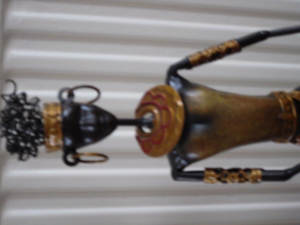 71488d110875 metal woman ornament. Blairgowrie