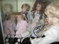 collectable dolls in glass case