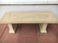 Heavy carved stone garden bench