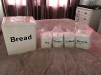 Tea coffee sugar biscuits bread tins