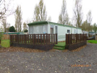 FREEHOLD CARAVAN PLOT on holiday park, with Static caravan
