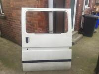 Ford transit side door with sliding glass