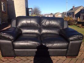 Top of the range black leather sofa.