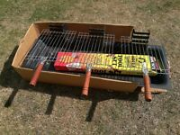 Small BBQ with cooking racks and tool kit included