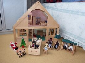 Early Learning Centre fully furnished Dolls House with 2 families, in good condition.