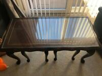 Nested coffee tables with glass tops
