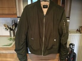 KARKI green bomber jacket size 10. IMMACULATE CLEAN CONDITION & BARGAIN PRICE. FESTIVAL MUST HAVE...