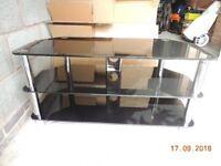 For sale black glass/chrome TV corner unit. Size W105cm x D45 x H53 good condition.