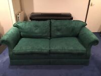 Large Green Damask Sofa Bed - Good condition, includes arm covers and mattress.