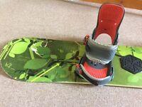 K2 Skyla 155 twin-tip snowboard. Bright green, with Burton bindings. Comes with salomon travel bag.