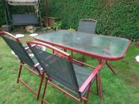 Metal garden table with glass top and 3 chairs