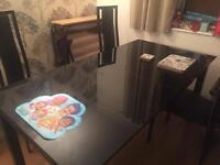 Harvey's extendable black glass 6-8 seater table