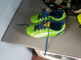 Kids size 11 green puma football boots