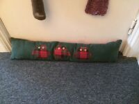 Gorgeous, thick door draught excluder cushion: will reduce heating bills!