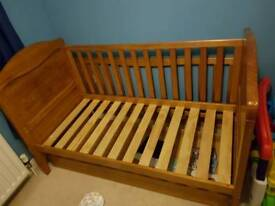 Solid antique pine cot/ toddler bed with winnie the pooh carving and storage drawer