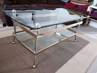 Lovely glass coffe table with glass shelf