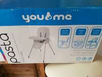 New high chair in box