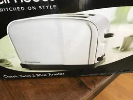 Russell Hobbs toaster new in box. Never been used. 2 slot toaster in Satin finish. (Silver)