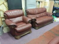 antique red coloured leather with solid oak trim 3 seater sofa and 2 chairs suite