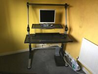Ergonomic computer station, with a large office chair.