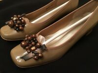 Beige patent leather ladies size 4 shoes; new