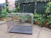Dog cage. Medium sized dog crate.