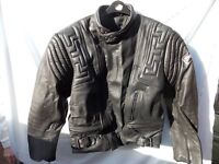 Motorccycle jacket and trousers in black leather.