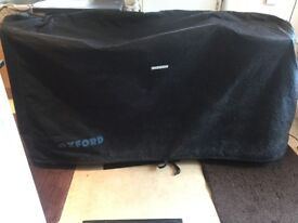 USED ,STILL IN GOOD CONDITION HEAVY DUTY MOTOR BIKE COVER COST THEN £80.00