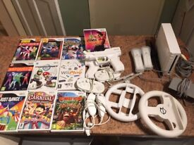 Wii Bundle 2 controllers, 10 Games, Nun-chucks, Steering Wheels, Gun Holsters