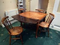 Four old kitchen chairs and draw leaf dining table. Condition reflects age though still used daily.