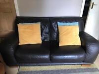 Large 2 seater brown leather sofa with matching pouffe