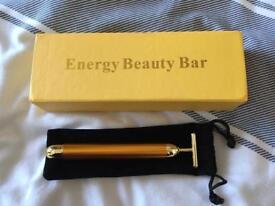 Golden T-bar facial massager.
