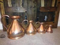 4 Victorian copper measuring jugs