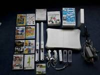 Wii with wii fit and games