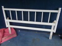 A WHITE PAINTED PINE DOUBLE HEADBOARD
