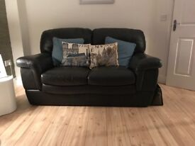 Italian leather 2 two seater sofas for sale. Dark brown in colour. Great condition