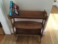 Antique arts and crafts book trough shelf