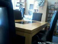 Table plus 6 leather chairs