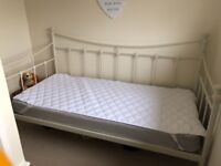 Single day bed, cream colour. Never used. Wooden slats. Mattress included. Collection only.