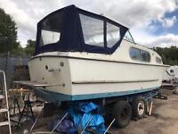 Boat. Freeman 23 with inboard engine and trailer