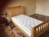 Single bed brand new never been used wooden head and foot board slatted wood includes mattress