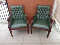 A Pair Of Green Leather Chesterfield Chairs