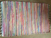 Small colourful stripy rug