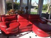 Red leather L shaped sofa